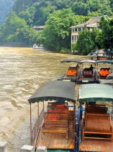 Motorized tourist boats along the Li River in Yangshuo, China