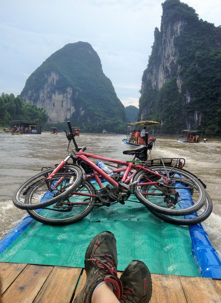 Rafting down the Li River in Yangshuo with karst peaks in the background