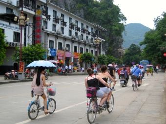 Bikers riding through the town of Yangshuo, China