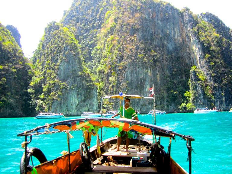 Our long-tail boat driver taking us to see the limestone cliffs in Ko Phi Phi, Krabi