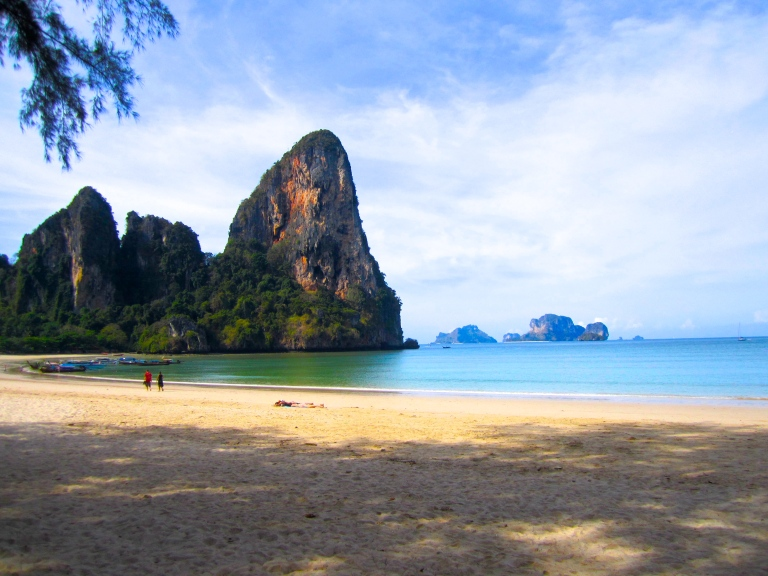 Massive limestone cliffs on the west side of Railay beach