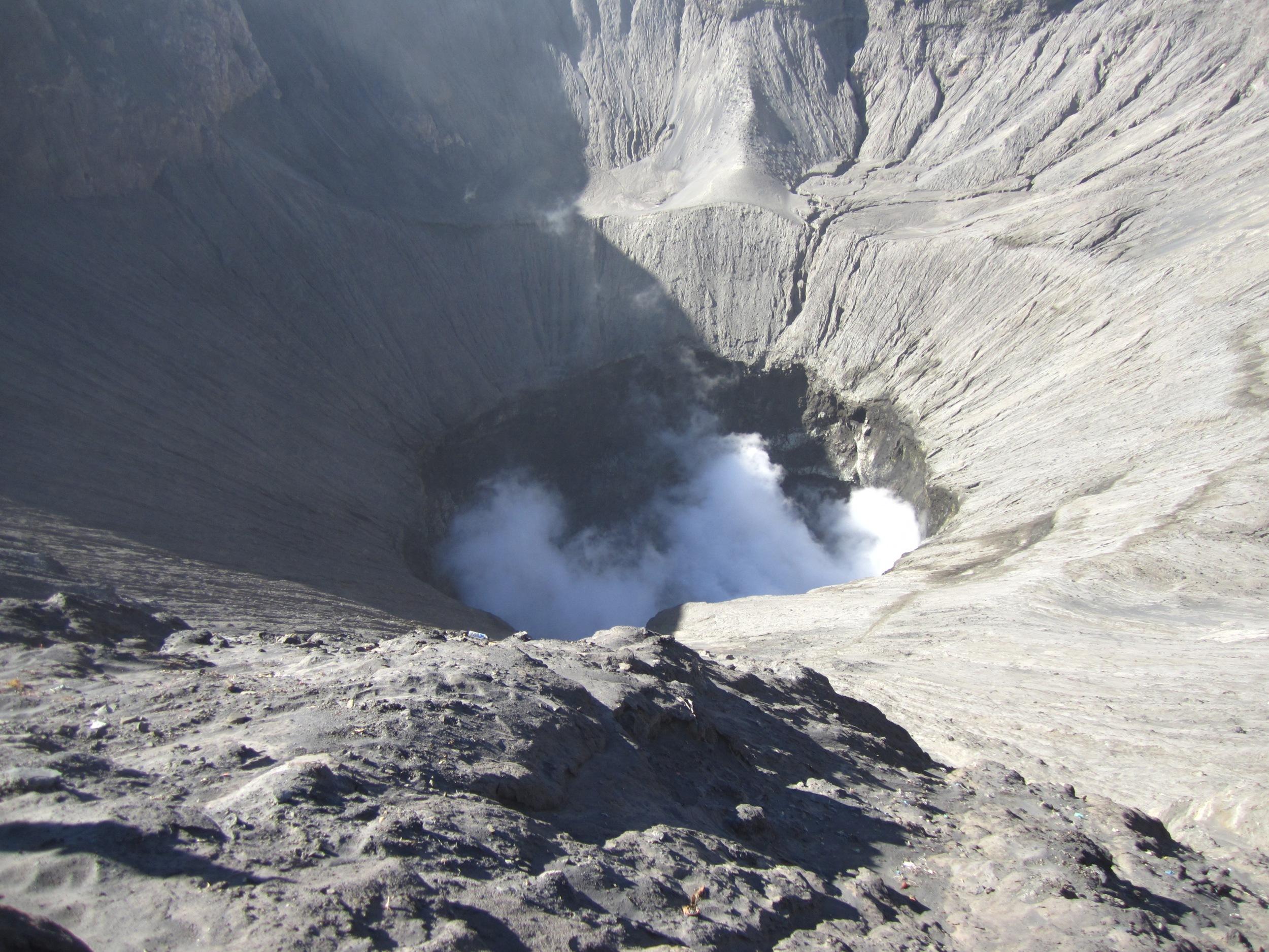 Bromo's massive crater spewing white sulphurous smoke