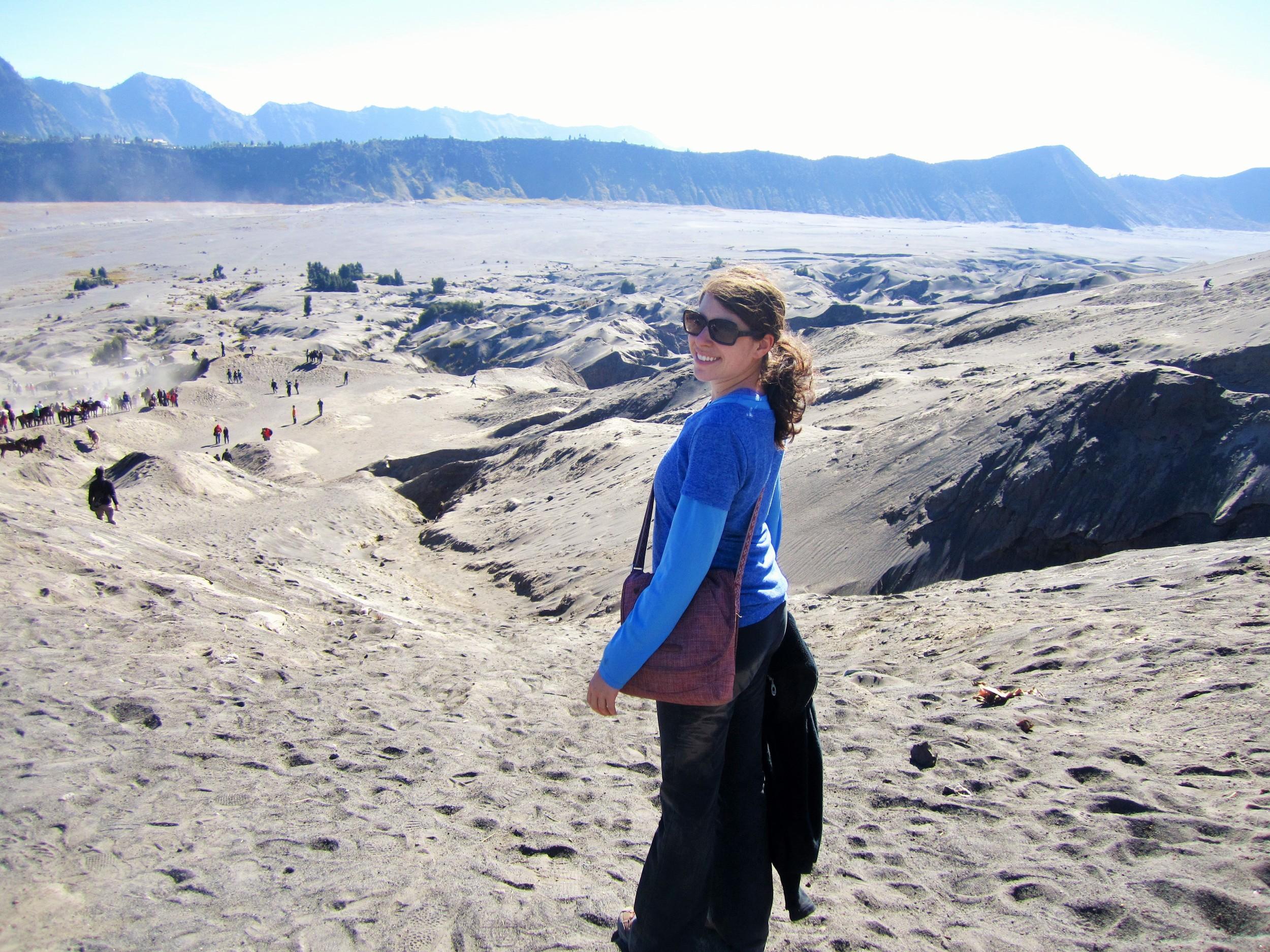 Walking through the sea of sand post climbing Mt. Bromo, part of the Tengger Massif