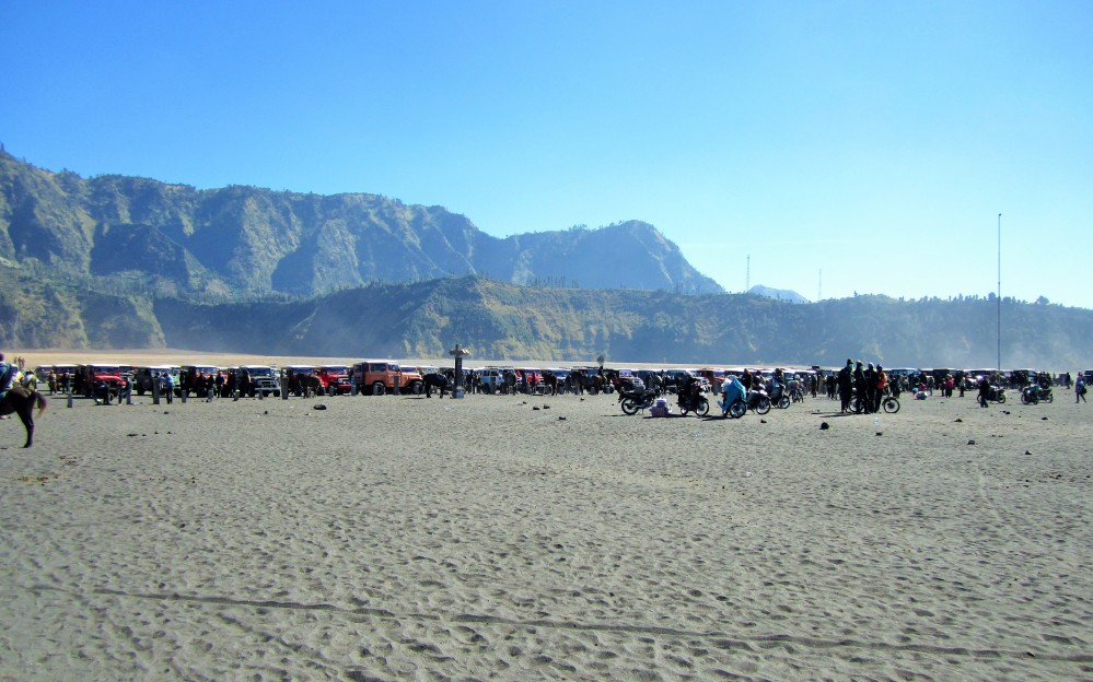 Jeeps parked on The Tengger Sand Sea in Tengger Caldera, East Java
