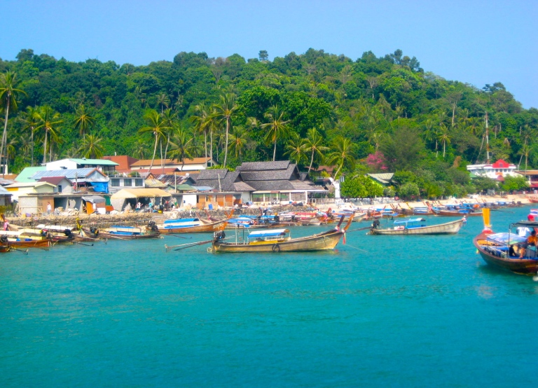 Scene of the long-tail boats on the beachfront near Long Beach in Krabi, Thailand