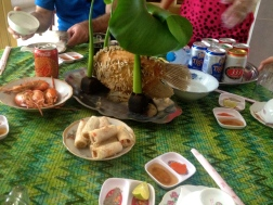 Our local meal at a villagers home in South Vietnam, consisting of fried fish, fresh shrimp and fried spring rolls