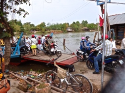 Groups of motorbikes in South Vietnam getting off the packed ferry