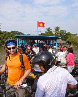 Riding on the transport ferry in the Mekong Delta
