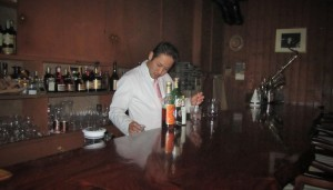 Our bartender at Bar Dolphy meticulously preparing cocktails