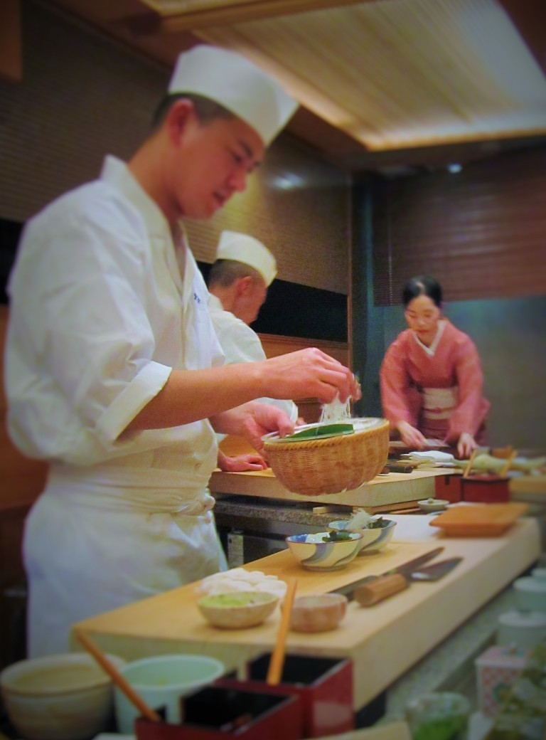 Kyubei's sushi chef preparing nigiri sushi for the diners