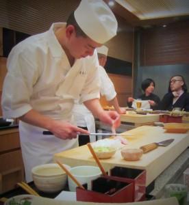 Sushi chef at Kyubei preparing the prawn sushi