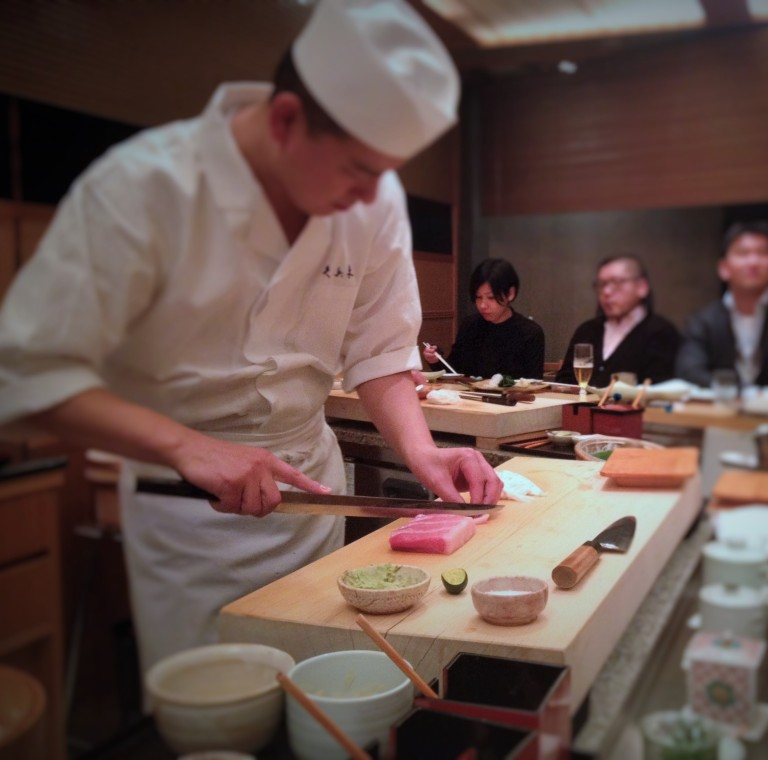 Our sushi chef at one of Tokyo's most prestigious sushi restaurants, Kyubei, slicing fresh tuna
