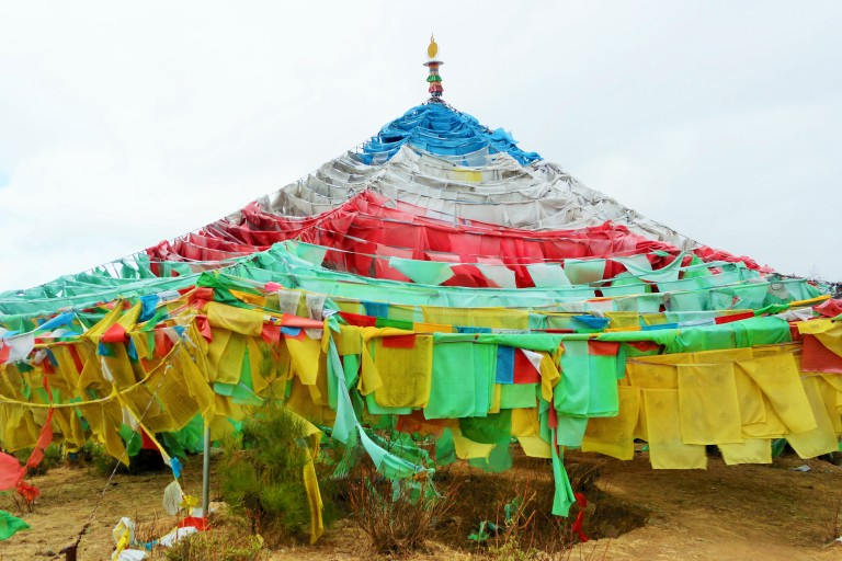 Tibetan prayer flags outside the Baiji Temple in Shangri-La, also known as the 100 Chicken Temple