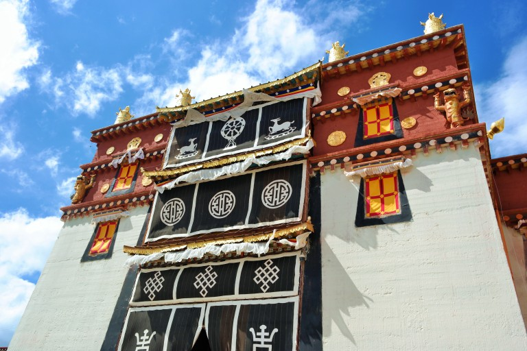Tibetan symbols hanging outside the  Songzanlin Monastery in Shangri-La, China