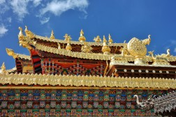Immaculately decorated gold emblems outside the Songzanlin Monastery, the largest Tibetan Buddhist monastey in Yunnan, China