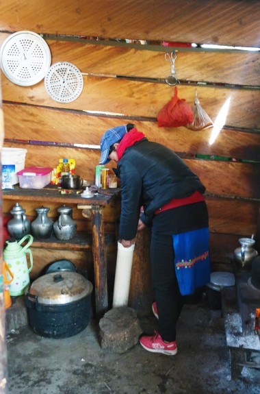 A Tibetan woman in Yubeng making Yak butter tea