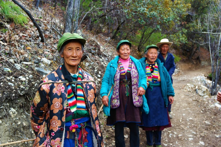 Elder men and women making the pilgrimage to the Sacred Waterfall in Yubeng, China
