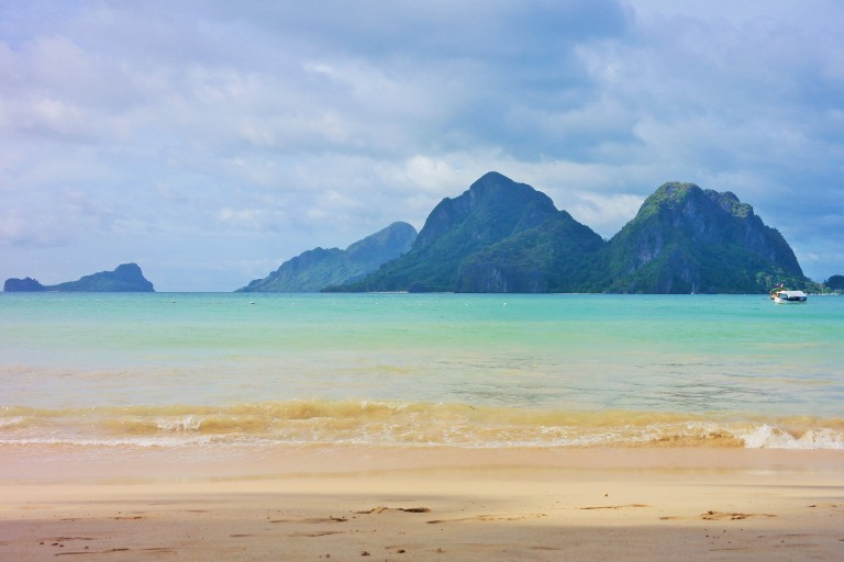 White sand and limestone karsts on Nacpan beach in El Nido