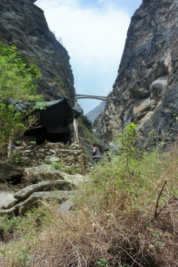 View of a small bridge connecting the Himalaya Mountains from the lower trail in Tiger Leaping Gorge