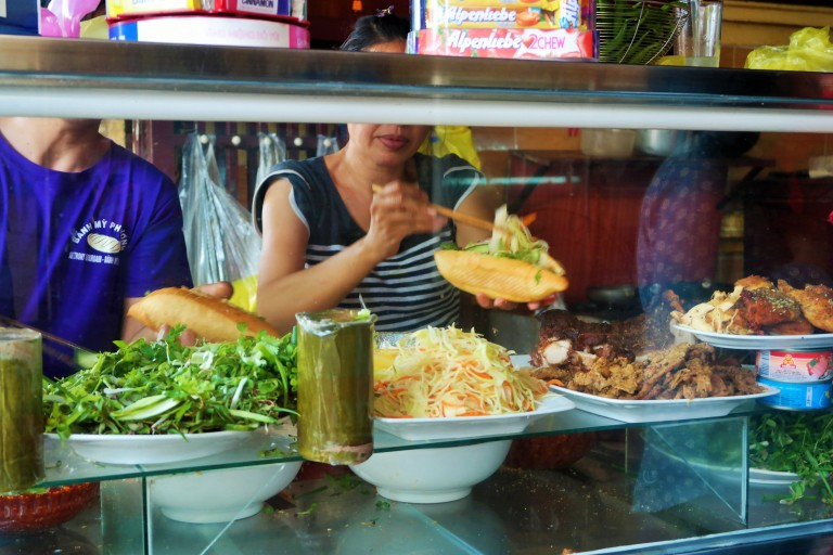 Woman making banh mi at Banh Mi Phuong in Hoi An's Old Town