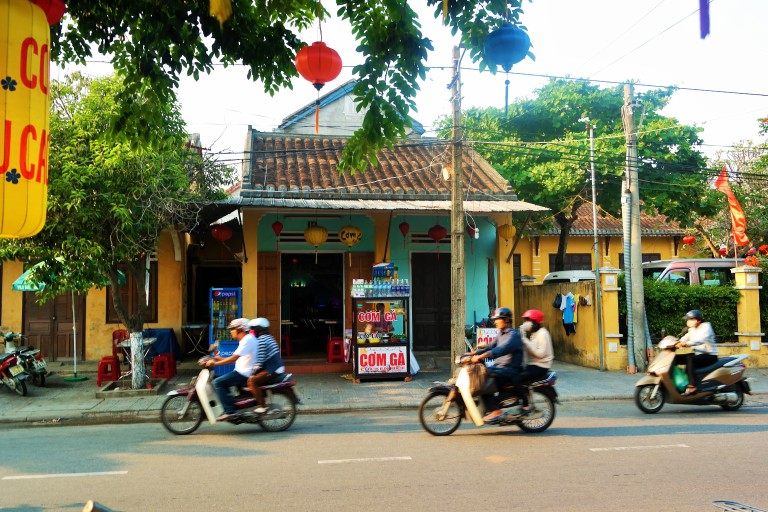 Locals motorbiking in Hoi An's Old Town