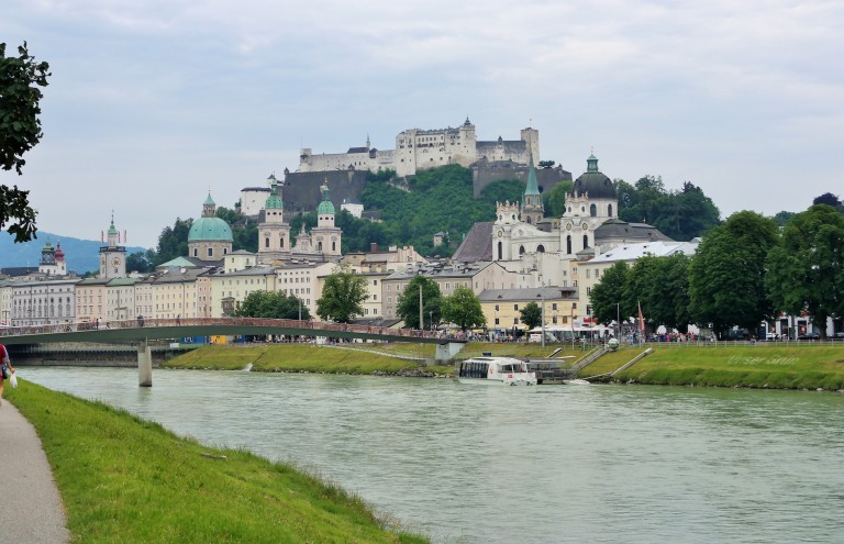 View of Salzburg's baroque architexture and the Hohensalzburg Castle along the Salzach River