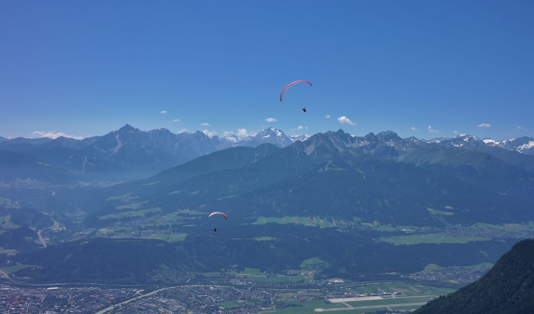Parasailers over the Alps in Innsbruck, Austria